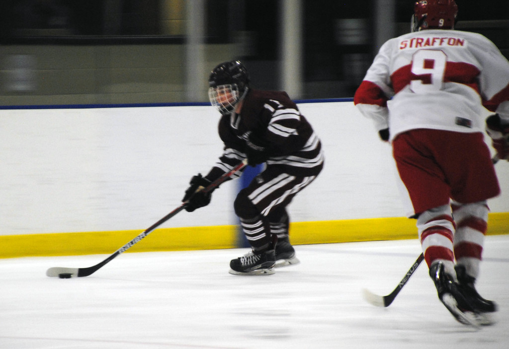 . Jon Behm - The Morning Journal<br> Rocky River junior Nolan Weaver works to get around Shaker Heights\' Stephen Straffon during the second period of the Baron Cup I final on Feb. 11 at Brooklyn\'s John M. Coyne Recreation Center.