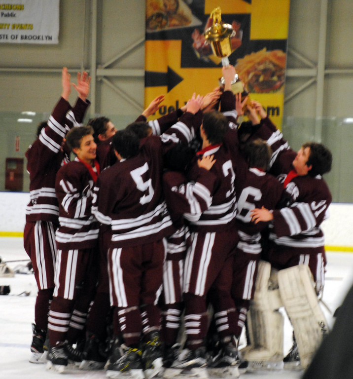 . Jon Behm - The Morning Journal<br> Rocky River hoists the Baron Cup I trophy after beating Shaker Heights 2-1 on Feb. 11 at Brooklyn\'s John M. Coyne Recreation Center.