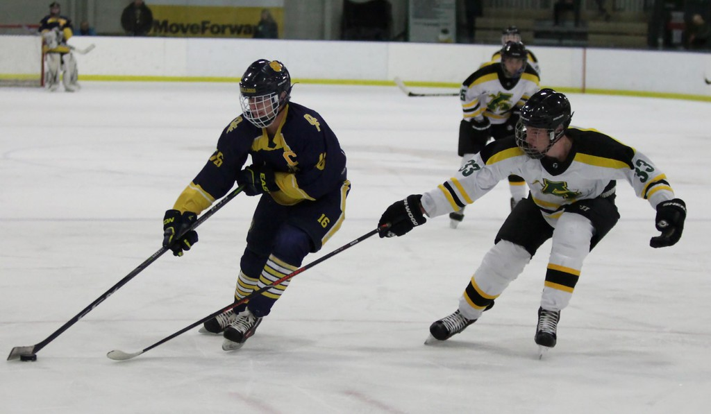 . Randy Meyers - The Morning Journal<br> Olmsted Falls\' Jacob Kerkay avoids the stick of Amherst\'s Tyler Waldecki as he moves the puck during the first period on Feb. 11.