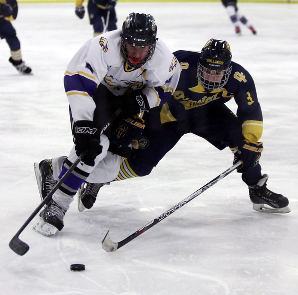 Randy Meyers - The Morning Journal<br /> Avon's Zach Zwiercki and Bailey   Carson of Olmsted Falls go after a loose puck near center ice during the   second period of the Division II Baron Cup finals on Sunday afternoon