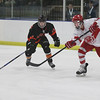 Randy Meyers - The Morning Journal<br /> North Olmsted's Riley Vertosnik and  Shaker's Dylan Shelton close in on a loose puck during the first period on  the Baron Cup finals on Sunday