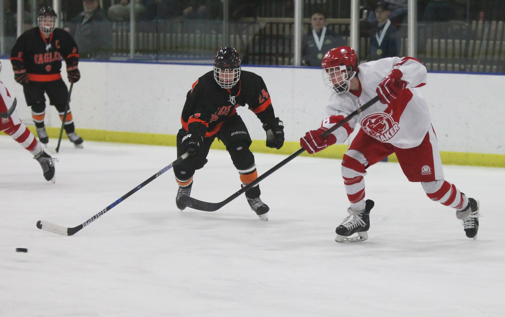 . Randy Meyers - The Morning Journal North Olmsted\'s Riley Vertosnik and  Shaker\'s Dylan Shelton close in on a loose puck during the first period on  the Baron Cup finals on Sunday