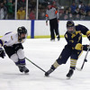Randy Meyers - The Morning Journal<br /> Olmsted Falls forward Bailey Carson   slaps the puck to a teamate in front of Avon's Christopher Reitman during   the second period of the Baron Cup finals on Sunday