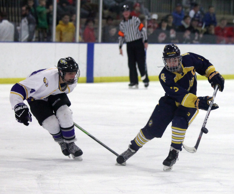 . Randy Meyers - The Morning Journal Olmsted Falls forward Bailey Carson   slaps the puck to a teamate in front of Avon\'s Christopher Reitman during   the second period of the Baron Cup finals on Sunday