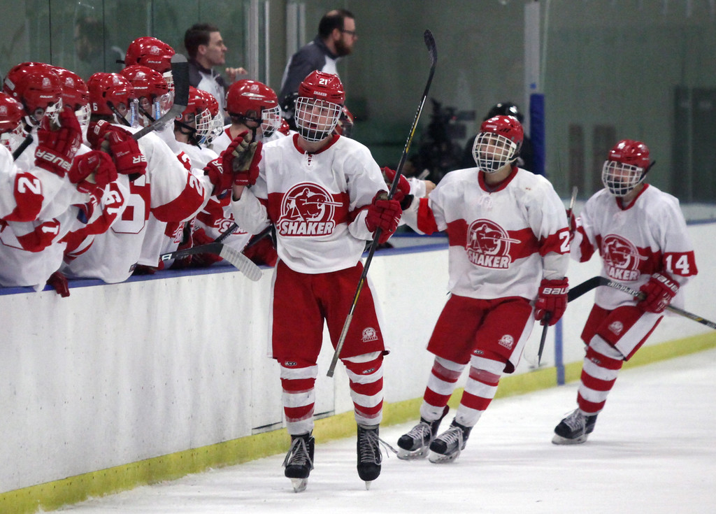 . Randy Meyers - The Morning Journal Shaker Heights players celebrate  with the rest of team after they scored a first period goal against North  Olmsted at the Baron Cup finals on Sunday