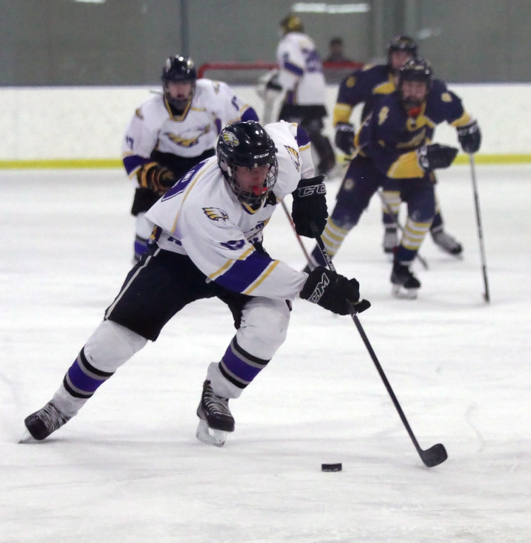 . Randy Meyers - The Morning Journal Avon senior Zach Zwiercki moves the   puck near center ice in front of the Olmsted Falls defense during the   second period on Sunday afternoon