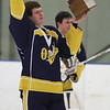 Randy Meyers - The Morning Journal<br /> Olmsted Falls senior Brett Gabel  holds up the Baron Cup Championship trophy and signals to the Falls fans in  attendance  after defeating Avon on Sunday afternoon