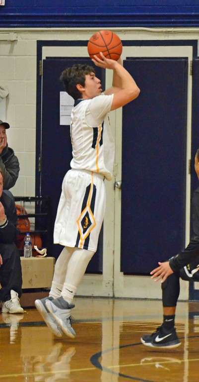 . Paul DiCicco - The News-Herald Wickliffe\'s Nicky Fenton shooting a 3-pointer early in the first quarter.