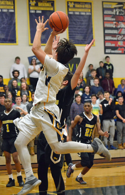 . Paul DiCicco - The News-Herald  Wickliffe\'s Nicky Fenton with a floater in the lane to bring Wickliffe closer late in the game.