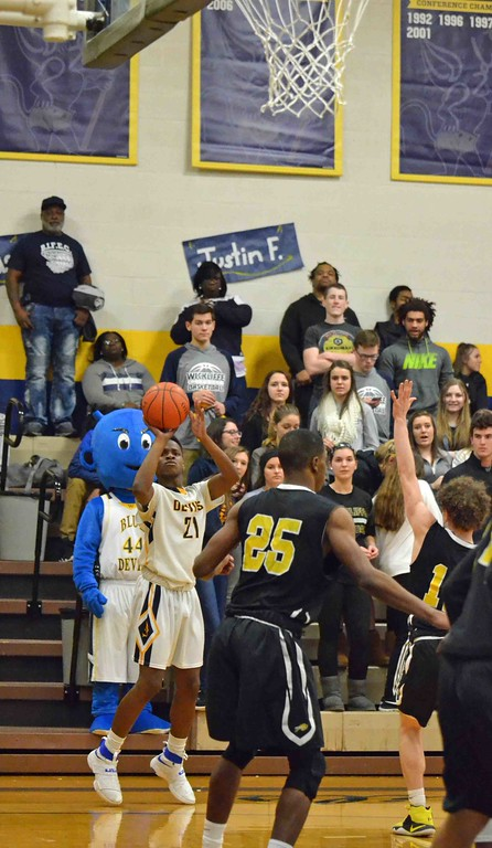 . Paul DiCicco - The News-Herald Wickliffe\'s Neshawn Brown lines up a 3-pointer in front of the Wickliffe student section.