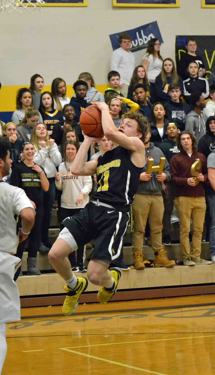 . Paul DiCicco - The News-Herald Beachwood\'s Ben Sternberg ending a fast-break after a Beachwood steal.