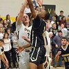 Paul DiCicco - The News-Herald<br /> Beachwood's Cameran Thomas completes a drive to the basket late in the first half, over an outstretched Justin Fortkamp.