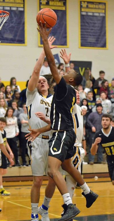 . Paul DiCicco - The News-Herald Beachwood\'s Cameran Thomas completes a drive to the basket late in the first half, over an outstretched Justin Fortkamp.