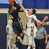 Paul DiCicco - The News-Herald<br /> Wickliffe's Bubba Turi attempts to block a shot against Beachwood's Josh Sizemore late in the game.