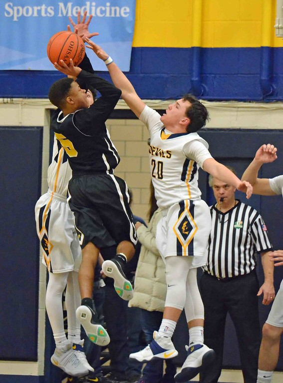 . Paul DiCicco - The News-Herald Wickliffe\'s Bubba Turi attempts to block a shot against Beachwood\'s Josh Sizemore late in the game.