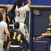Paul DiCicco - The News-Herald<br />  Wickliffe's Jaysen Lewis rising up over the Beachwood defense.