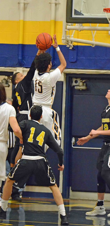 . Paul DiCicco - The News-Herald  Wickliffe\'s Jaysen Lewis rising up over the Beachwood defense.