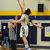 Paul DiCicco - The News-Herald<br />  Opening Tip between host Wickliffe Blue Devils and the Beachwood Bison on Feb 13.  Beachwood went on to win on a last second layup, 61-59.
