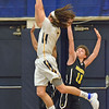 Paul DiCicco - The News-Herald<br /> Wickliffe's Justin Fortkamp taking it strong to the basket against a Beachwood double-team.