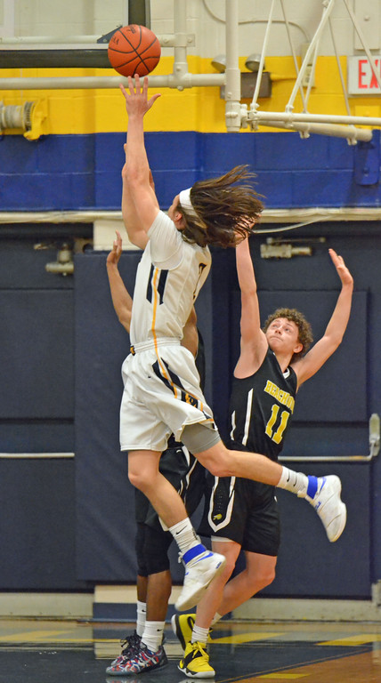 . Paul DiCicco - The News-Herald Wickliffe\'s Justin Fortkamp taking it strong to the basket against a Beachwood double-team.