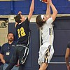 Paul DiCicco - The News-Herald<br /> Beachwood's Jayson Woodrich was a little late on a Justin Fortkamp inside move to the basket.