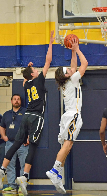 . Paul DiCicco - The News-Herald Beachwood\'s Jayson Woodrich was a little late on a Justin Fortkamp inside move to the basket.