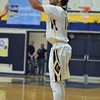 Paul DiCicco - The News-Herald<br /> Wickliffe's Jaysen Lewis attempts a 3-pointer against Beachwood.