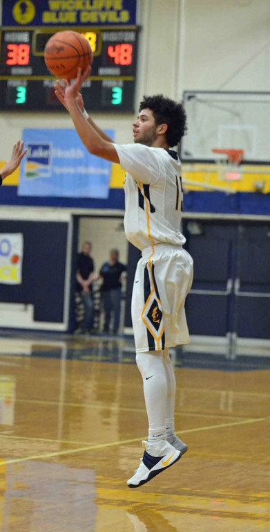 . Paul DiCicco - The News-Herald Wickliffe\'s Jaysen Lewis attempts a 3-pointer against Beachwood.