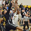 Paul DiCicco - The News-Herald<br /> Beachwood's Josh Sizemore playing tight defense against a driving Neshawn Brown from Wickliffe.