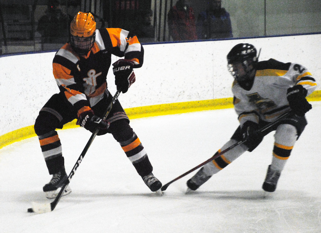 . Jon Behm - The Morning Journal<br> Avon Lake\'s Connor Koncelik protects the puck from Amherst\'s Jacob Kramer during the first period of a Brooklyn District first round game on Feb. 13 at Brooklyn\'s John M. Coyne Recreation Center.