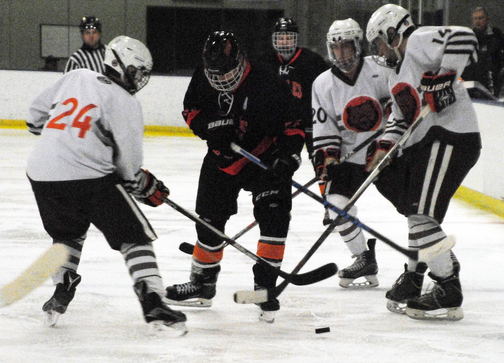 . Jon Behm - The Morning Journal<br> North Olmsted junior Riley Vertosnik tries to work through a trio of Padua players during the second period of a Brooklyn District first round game on Feb. 13 at Brooklyn\'s John M. Coyne Recreation Center.