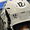 Jon Behm - The Morning Journal<br /> Elyria Catholic and Rocky River wore decals on the back of their helmets honoring Alec Kornet, a member of the Brush hockey team who passed away on Feb. 14, during their OHSAA brooklyn District first round game on Feb. 15 at Brooklyn's John M. Coyne Recreation Center.