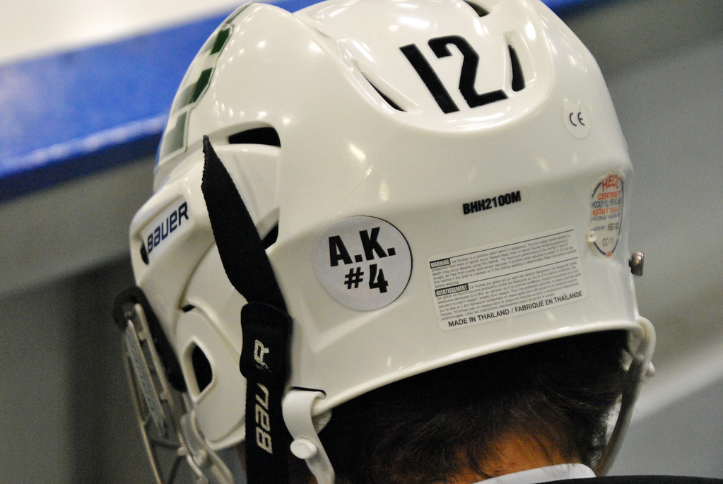 . Jon Behm - The Morning Journal Elyria Catholic and Rocky River wore decals on the back of their helmets honoring Alec Kornet, a member of the Brush hockey team who passed away on Feb. 14, during their OHSAA brooklyn District first round game on Feb. 15 at Brooklyn\'s John M. Coyne Recreation Center.