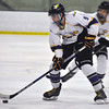 Jon Behm - The Morning Journal<br /> Avon junior Gabe Intagliata works the puck up ice during the third period of an OHSAA Brooklyn District first round game against Chagrin Falls at Brooklyn's John M. Coyne Recreation Center on Feb. 15.