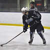 Jon Behm - The Morning Journal<br /> Benedictine sophomore Matt Carson brings the puck behind the net during the first period of an OHSAA Brooklyn District first round game against Parma on Feb. 15 at Brooklyn's John M. Coyne Recreation Center.