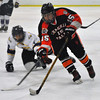 Jon Behm - The Morning Journal<br /> Chagrin Falls sophomore Joe Conway (15) skates around the defense of Avon junior Gabe Intagliata during the second period of an OHSAA Brooklyn District first round game at Brooklyn's John M. Coyne Recreation Center on Feb. 15.
