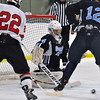 Jon Behm - The Morning Journal<br /> Benedictine goalie Tristan Cotter makes a save as teammate Nick Moner (12) and Parma's Joey Gallo (22) watch during the first period of an OHSAA Brooklyn District first round game on Feb. 15 at Brooklyn's John M. Coyne Recreation Center.
