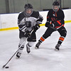 Jon Behm - The Morning Journal<br /> Strongsville's Logan Schramm (28) tries to skate up ice as North Olmsted senior Justin Malinak defends during the first period of an OHSAA Brooklyn District first round game on Feb. 16 at Brooklyn's John M. Coyne Recreation Center.