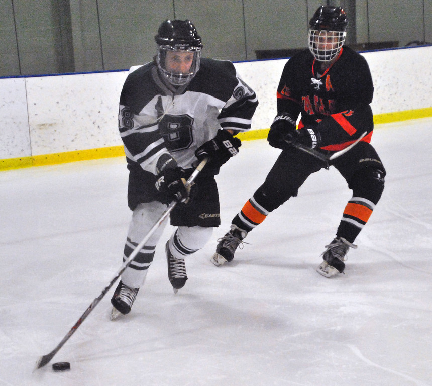 . Jon Behm - The Morning Journal Strongsville\'s Logan Schramm (28) tries to skate up ice as North Olmsted senior Justin Malinak defends during the first period of an OHSAA Brooklyn District first round game on Feb. 16 at Brooklyn\'s John M. Coyne Recreation Center.