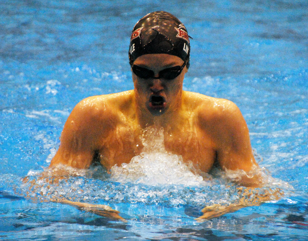 . Jon Behm - The Morning Journal<br> Rocky River senior Elijah Linville swims the 100 breaststroke at the Division II Northeast District meet on Feb. 16 at Cleveland State\'s Robert F. Busbey Natatorium. Linville placed third in the event with a time of 1:00.30.
