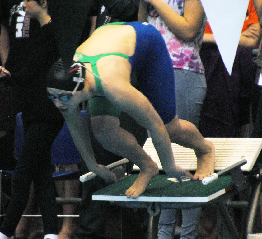 . Jon Behm - The Morning Journal<br> Bay sophomore Maja Miedza comes off the blocks for her 50 freestyle swim at the Division II Northeast District meet on Feb. 16 at Cleveland State\'s Robert F. Busbey Natatorium. Miedza placed third in the event with a time of 24.05.