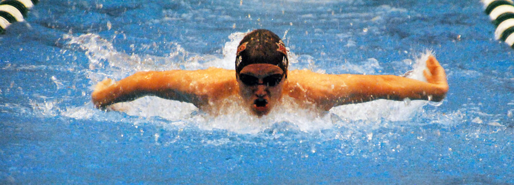 . Jon Behm - The Morning Journal<br> Rocky River senior Elijah Linville swims the backstroke leg of the 200 Individual Medley at the Division II Northeast District meet on Feb. 16 at Cleveland State\'s Robert F. Busbey Natatorium. Linville placed seventh in the event with a time of 2:01.41.