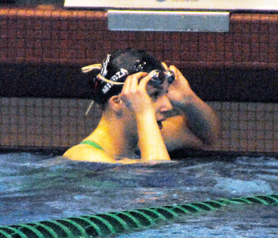 . Jon Behm - The Morning Journal<br> Bay sophomore Maja Miedza reacts after seeing her time in the 50 freestyle at the Division II Northeast District meet on Feb. 16 at Cleveland State\'s Robert F. Busbey Natatorium. Miedza placed third in the event with a time of 24.05.