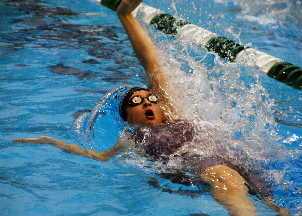 . Jon Behm - The Morning Journal<br> Bay\'s Gabby Mastromatteo swims the backstroke leg of the 200 medley relay at the Division II Northeast District meet on Feb. 16 at Cleveland State\'s Robert F. Busbey Natatorium.