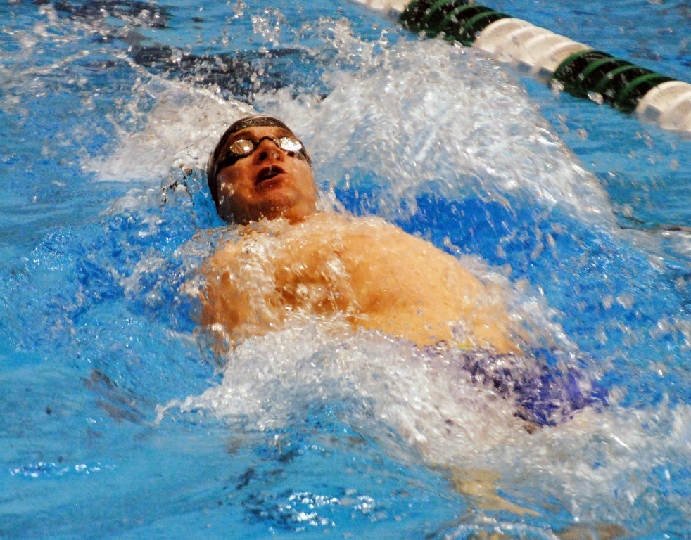 . Jon Behm - The Morning Journal<br> The backstroke leg of Bay\'s 200 medley relay at the Division II Northeast District meet on Feb. 16 at Cleveland State\'s Robert F. Busbey Natatorium.