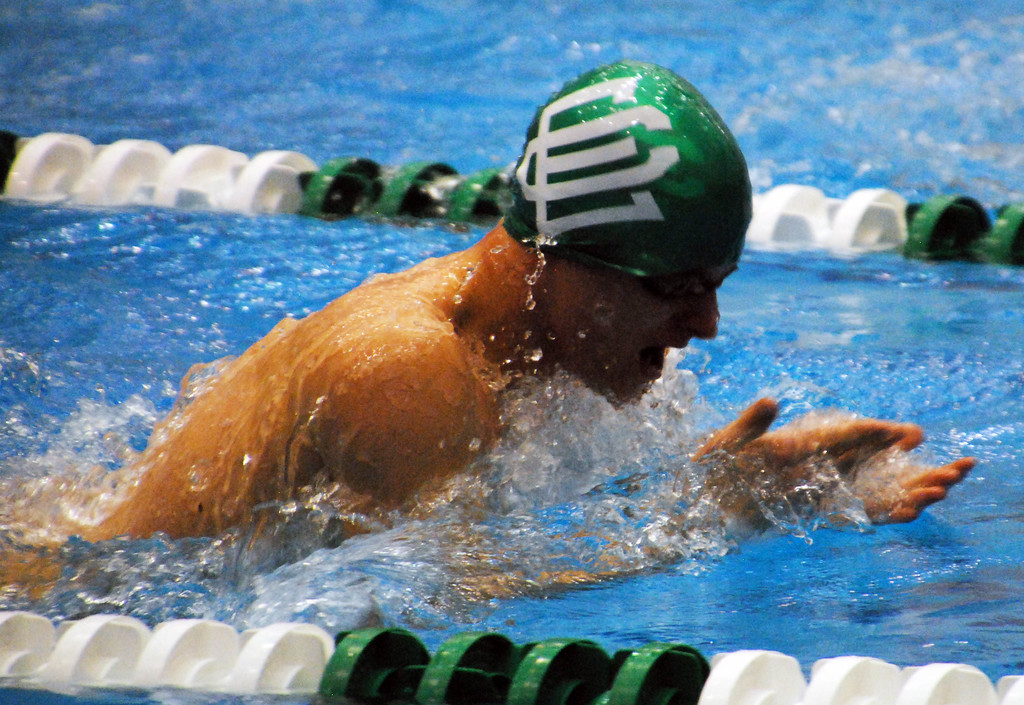 . Jon Behm - The Morning Journal<br> Elyria Catholic\'s Andy Brown swims the breaststroke leg of the 200 medley relay at the Division II Northeast District meet on Feb. 16 at Cleveland State\'s Robert F. Busbey Natatorium.