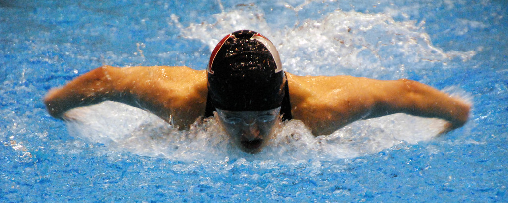 . Jon Behm - The Morning Journal<br> Hawken\'s Abby Hay swims the butterfly leg of the 200 Individual Medley at the Division II Northeast District meet on Feb. 16 at Cleveland State\'s Robert F. Busbey Natatorium. Hay placed second in the event to automatically qualify for the state meet next week.