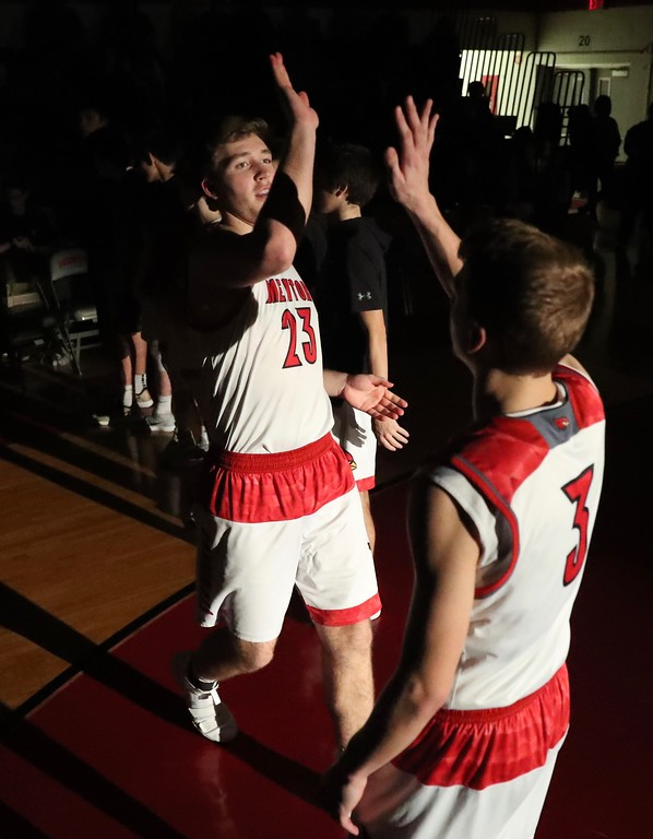 . Tim Phillis - The News-Herald Action from the Feb. 16 Medina-Mentor boys basketball game.