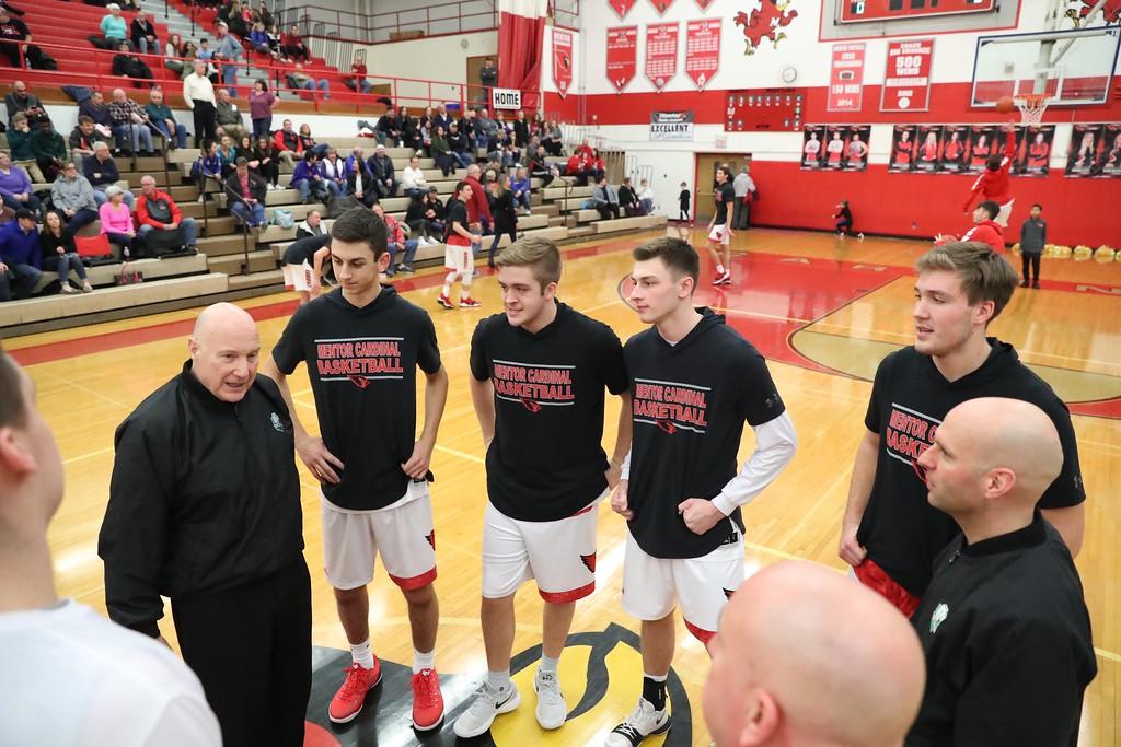 . Tim Phillis - The News-Herald Action from the Feb. 16 Medina-Mentor boys basketball game.
