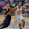 Paul DiCicco - The News-Herald<br /> Euclid's Delana Harper boxes out a Cleveland Heights defender after a free throw.